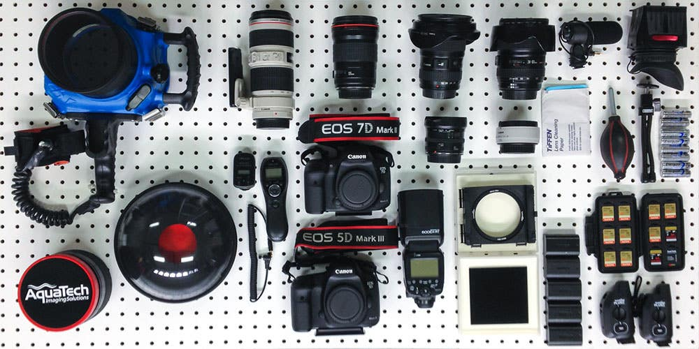 (From Top Left) Aquatech Housing, Canon 70-200mm f2.8 L IS, Canon 135mm f2 L, Canon 16-35mm f2.8 L, Canon 24-105mm f4 L IS, Video Mic, LCD Viewfinder, Wireless Shutter Release, Canon 7D MKII, Canon 15mm f2.8, Canon 1.4x Tele-converter, Lens Paper, Blower